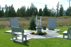 Memorial Garden in Invermere, BC, provided and installed by Kootenay Monument, features memorial benches, statuary and memorial books.